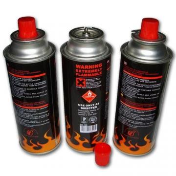 Empty butane gas cartridge and camping gas butane canister refill for barbecue in the wild